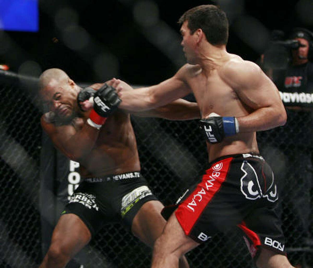 Lyoto Machida, right, trades punches with Rashad Evans.