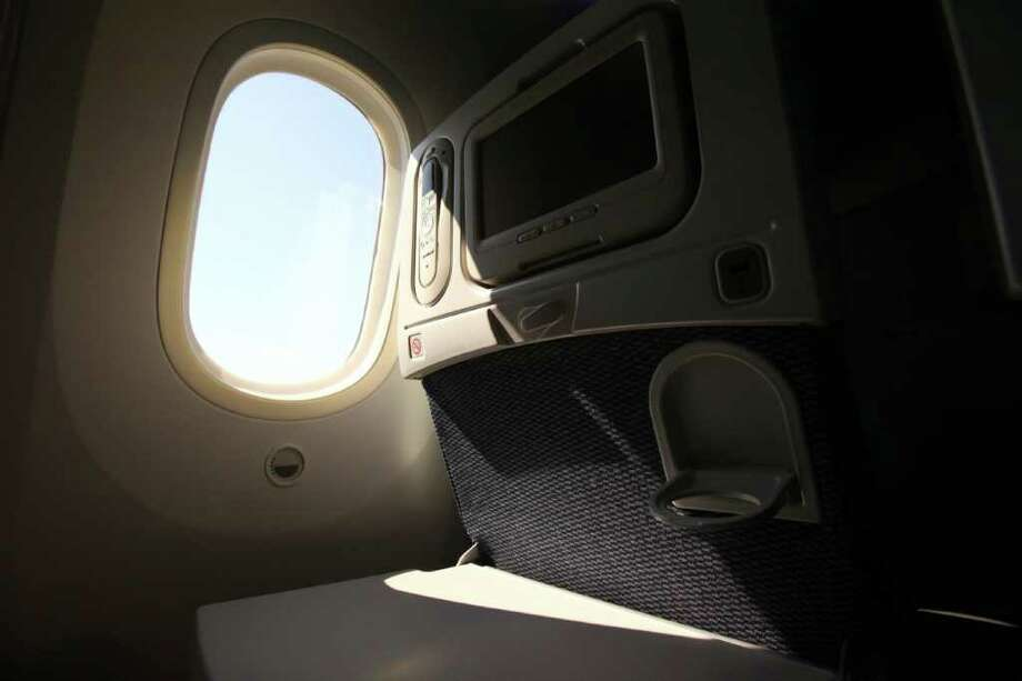 A seat back and window are shown during the reveal of the first Boeing 787 destined for use by launch customer All Nippon Airways. Photo: JOSHUA TRUJILLO / SEATTLEPI.COM