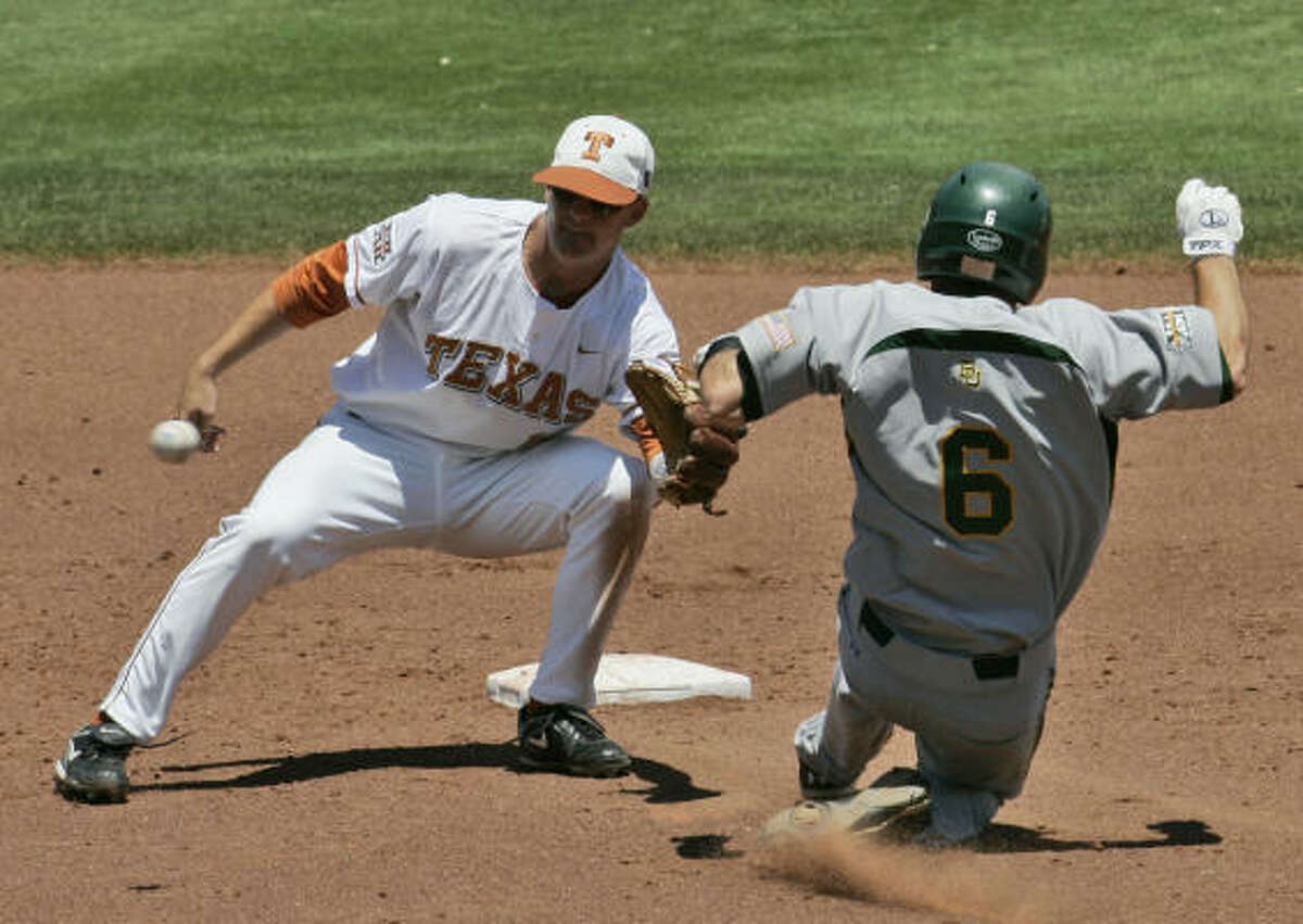 Texas shortstop Brandon Loy takes the throw in time to tag out Baylor's Raynor Campbell as he attempts to steal second base in the third inning.