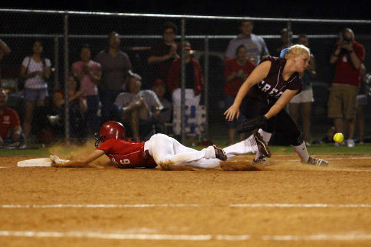 Katy's Darian Blake slides into third base to beat the throw against Clear Creek Friday.