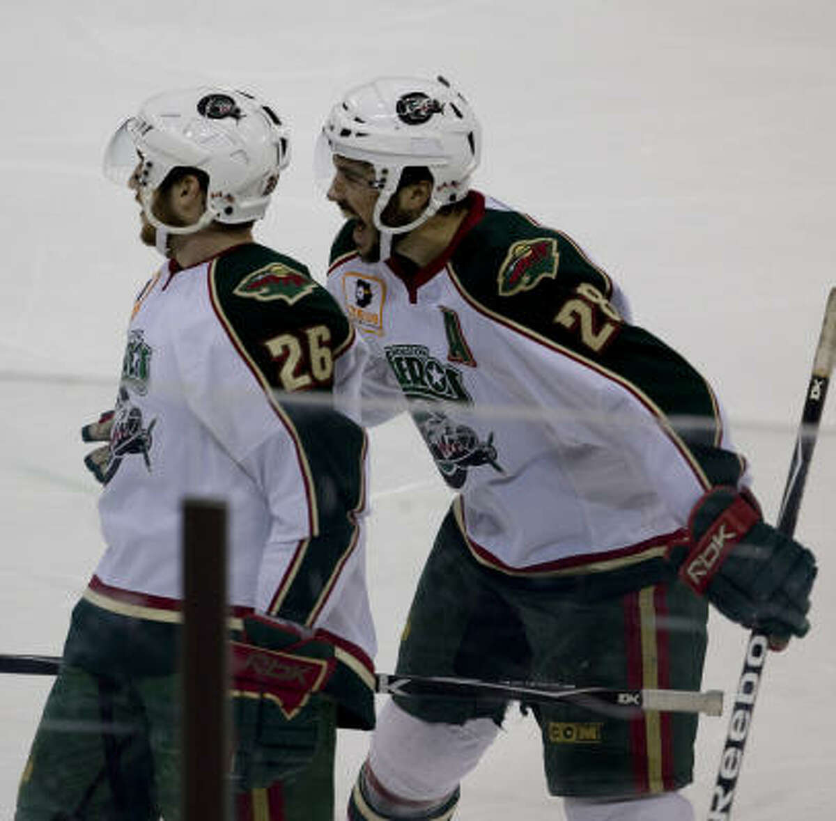 Aeros' Brandon Rogers (28) celebrates with Maxim Noreau (26) after scoring in the first period.