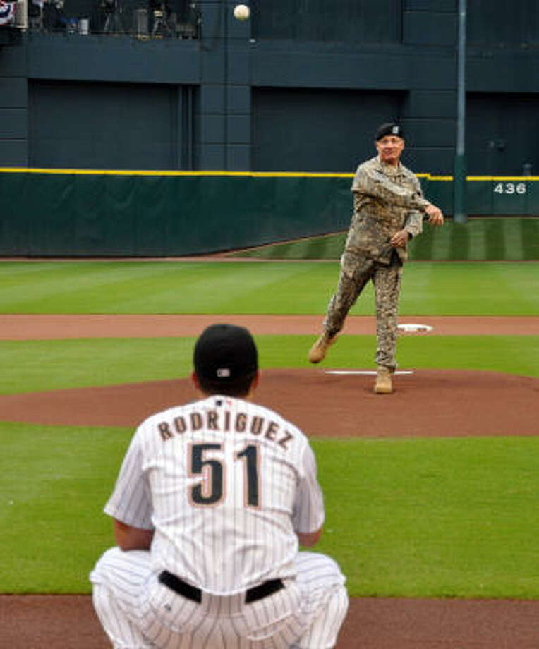 Date: May 22 Series: Astros vs. Rangers Game: 1 Major General Jeffrey Hammond throws out the first pitch Friday night to kick off Memorial Day weekend. Photo: Chris Elliott, For The Chronicle