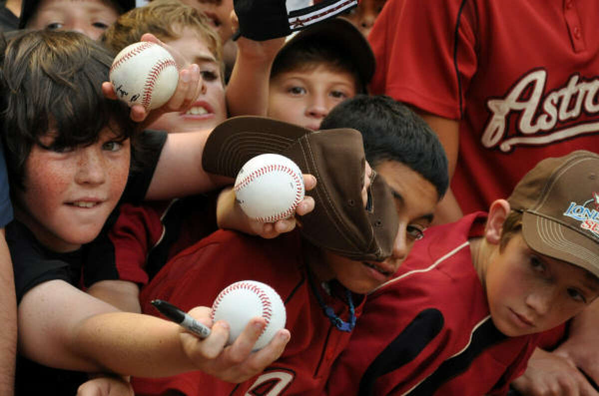 Date: May 22 Series: Astros vs. Rangers Game: 1 Young Astros fans extend their arms for the chance of getting souvenirs signed.