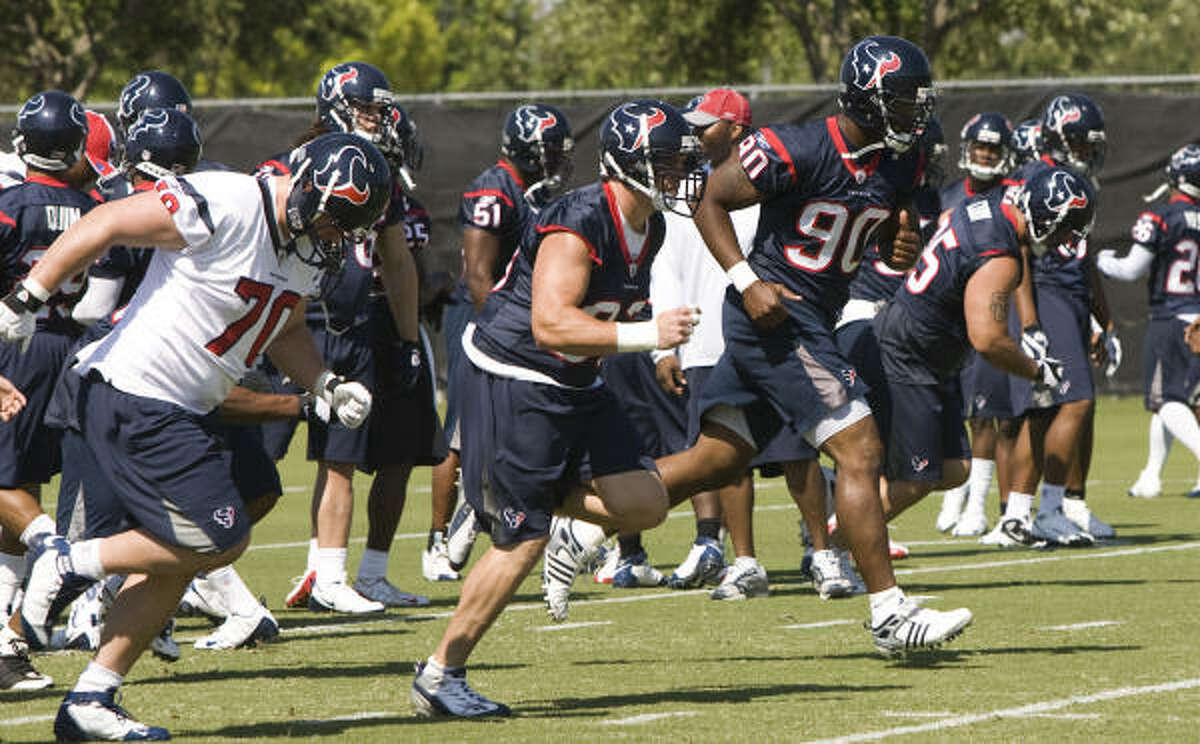 Defensive end Mario Williams (90) runs sprints as he warms up before practice Tuesday t Reliant Park.