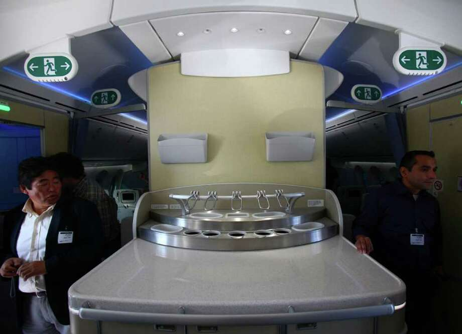 A bar area is shown in the cabin during the reveal of the first Boeing 787 destined for use by launch customer All Nippon Airways. Photo: JOSHUA TRUJILLO / SEATTLEPI.COM