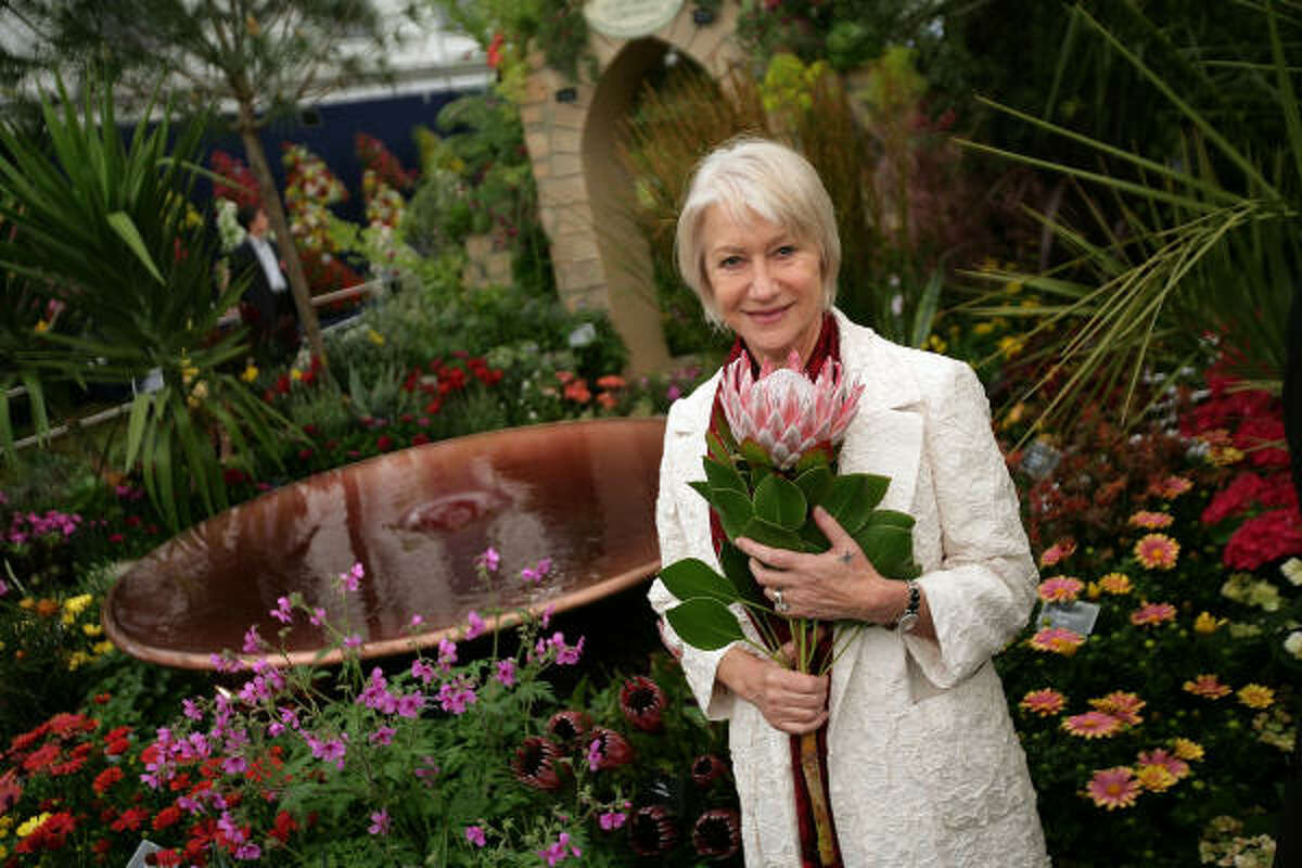 MAY 18: Prince's Trust Ambassador Dame Helen Mirren poses for a photograph on the Burncose Nurseries stand at Chelsea Flower Show.