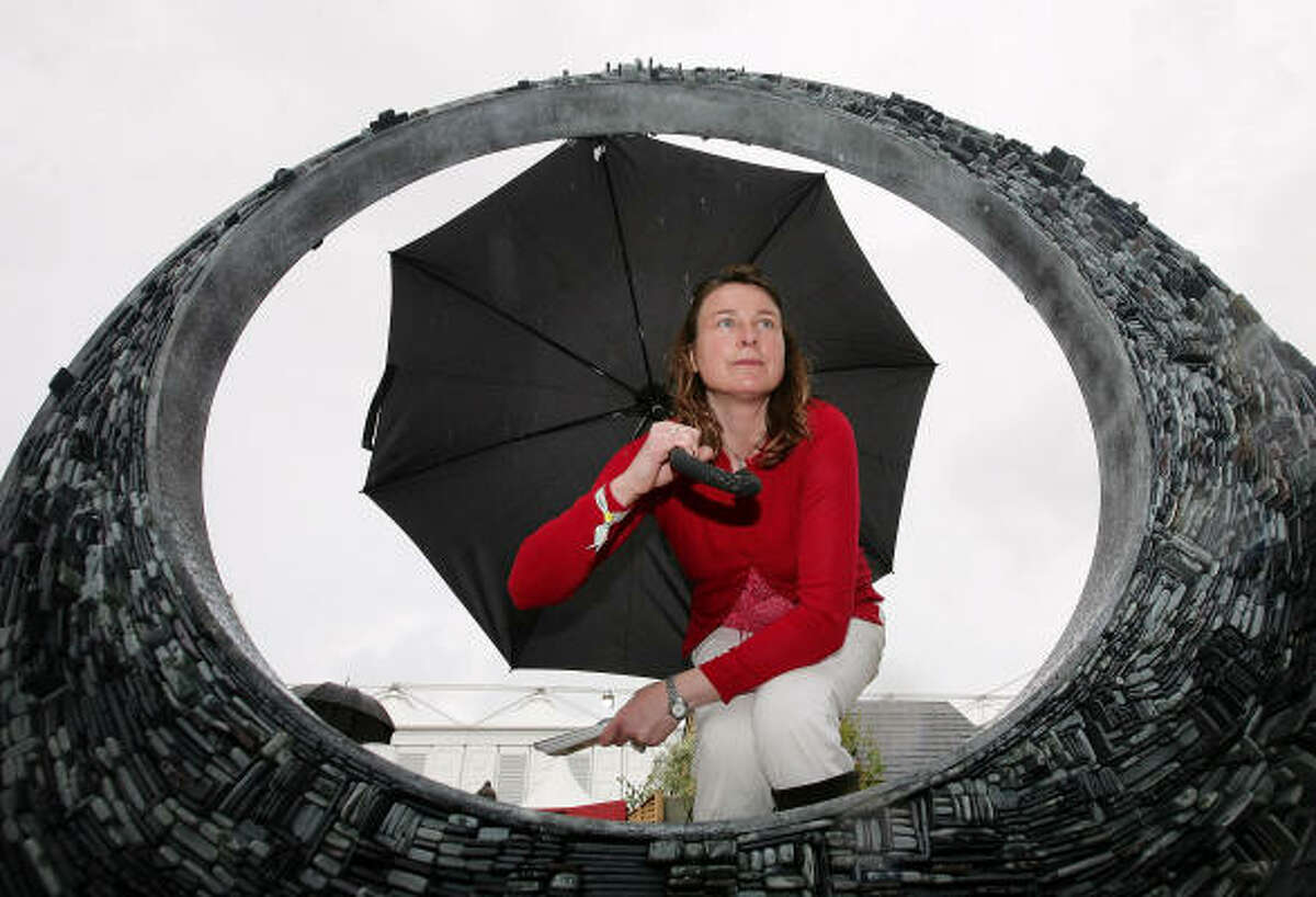 MAY 19: A woman looks through a garden sculpture at Chelsea Flower Show.