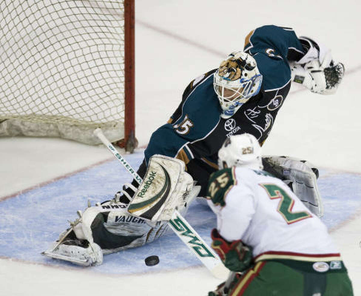 Manitoba Moose goalie Cory Schneider makes a save on a shot from Aeros' Matt Beaudoin during the first period.