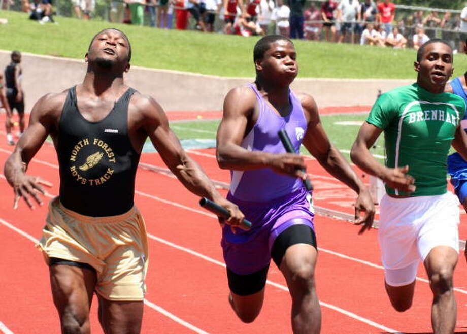 DeWayne Buggs of North Forest (left) edges Angelton's Terrence Franks (middle) and Brenham's Kendrick Wasington to take gold in the 400-meter relay in 41.97 seconds. Photo: Gerald James, Houston Chronicle