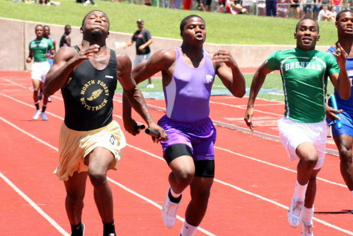 Runners competing in the Boys 400 relay.