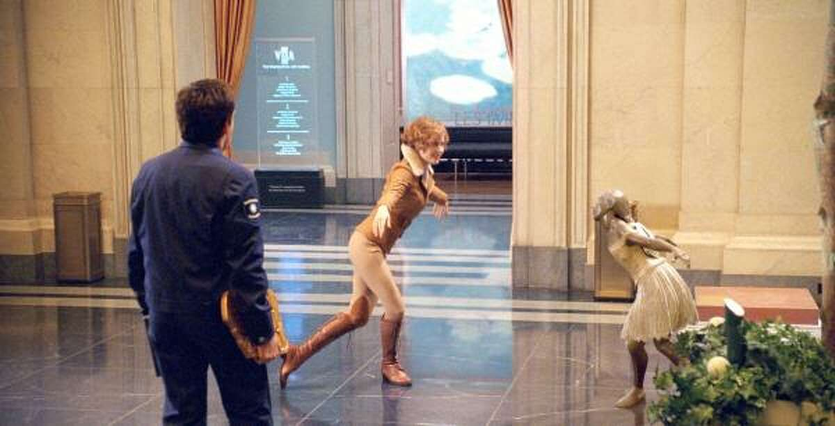 A statue come to life triggers a flight of fancy from Amelia Earhart (Amy Adams), as Larry Daley (Ben Stiller) looks on.