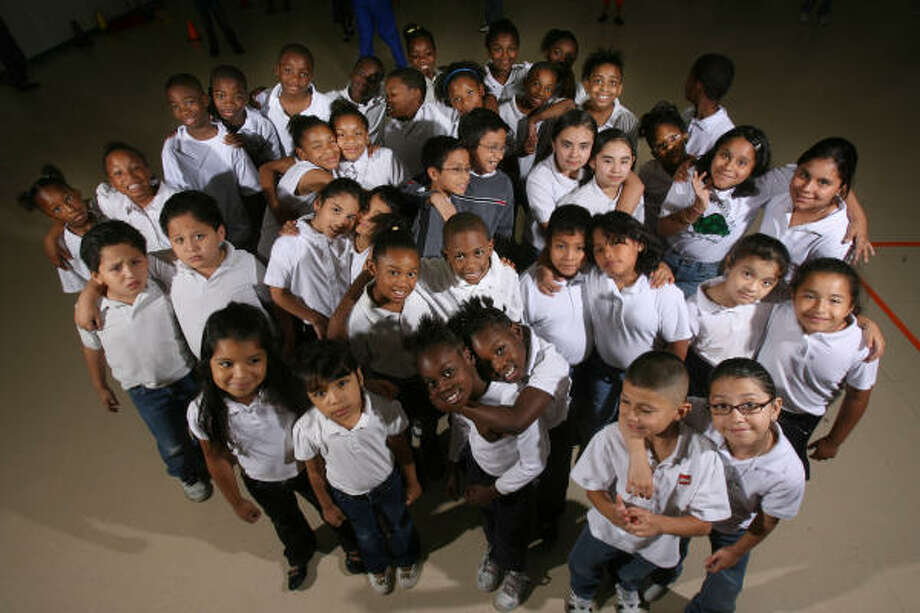"Tinsley Elementary School has 19 sets of twins and one set of triplets this semester. Students are photographed in the school gym, and staff calls them the ""Tinsley Twins."" Photo: Mayra Beltran, Chronicle"