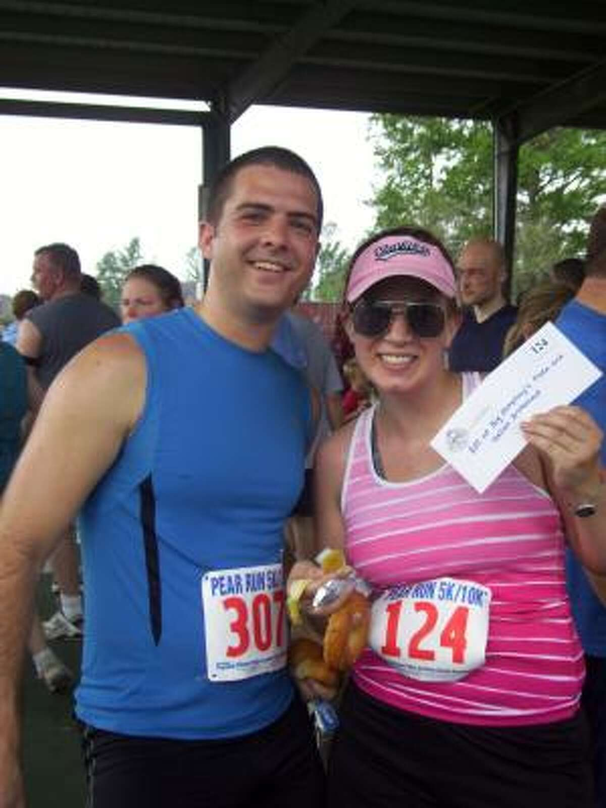 Addison Tackaberry, left, is seen with his friend Julie Brasefield, who won a $25 gift certificate to Humphrey's after the run.