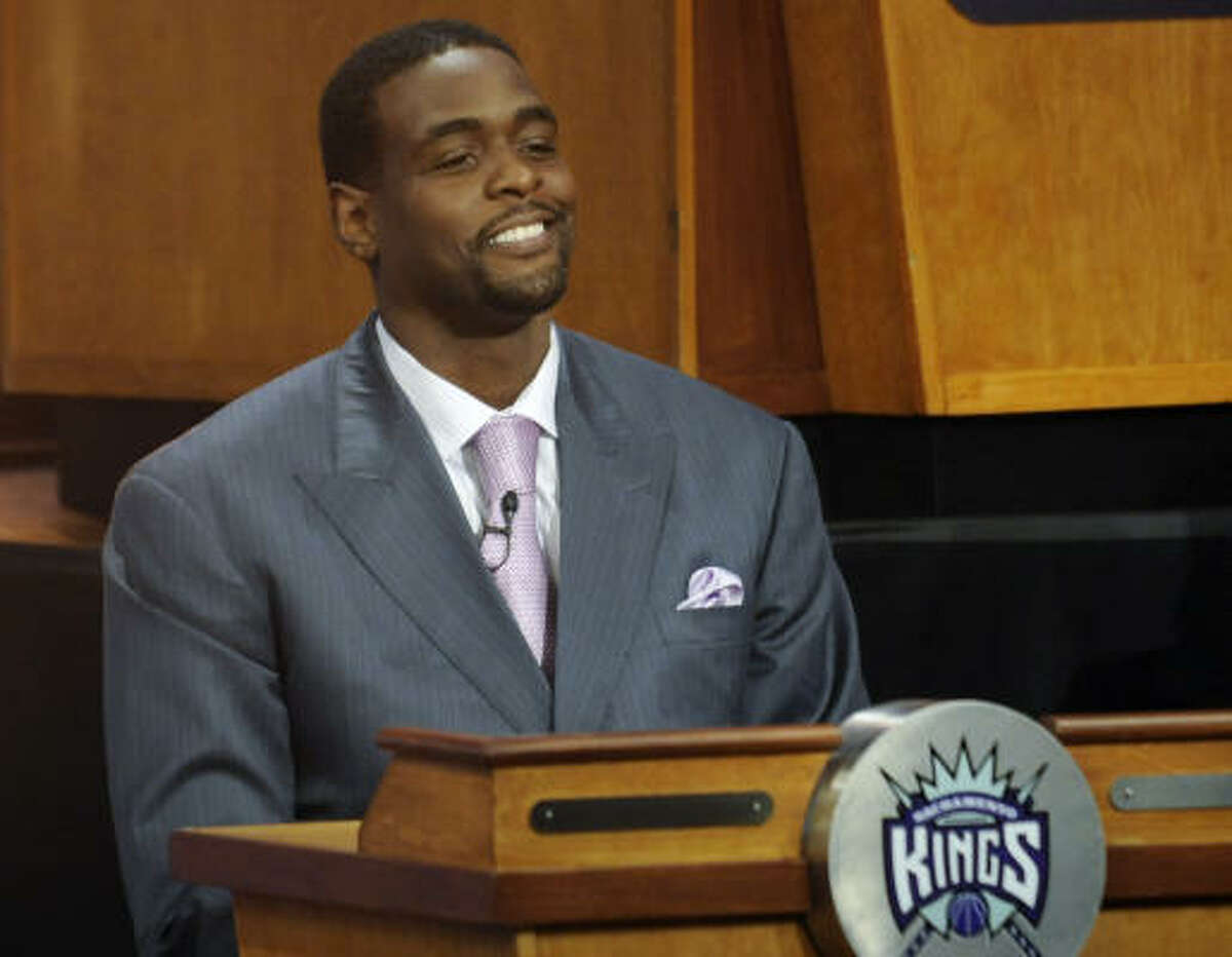 Sacramento Kings representative Chris Webber smiles through his disappointment after the Kings did not receive the top pick in the NBA draft lottery.