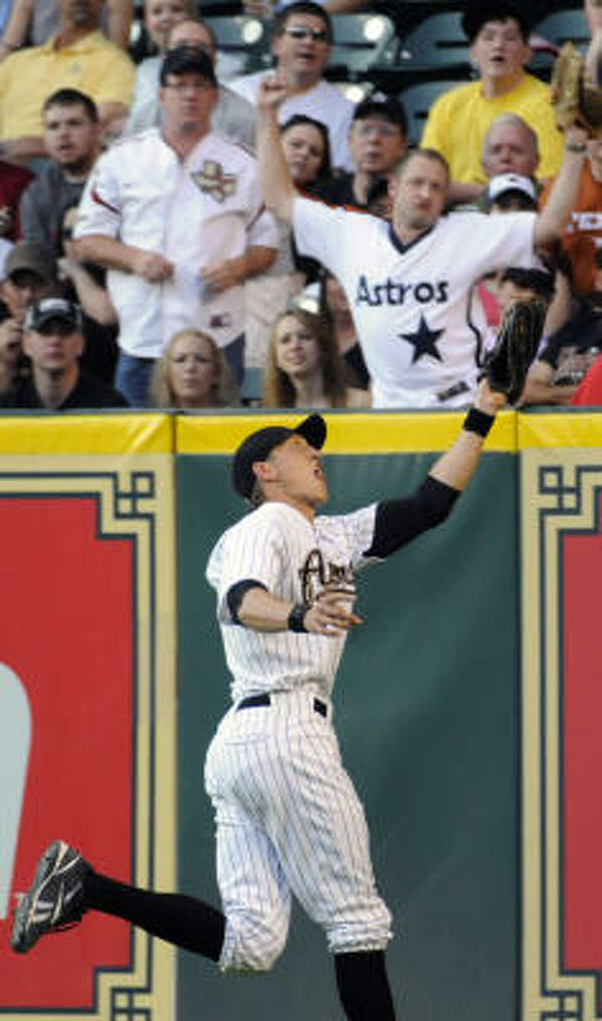 Houston Astros right fielder Hunter Pence makes the catch for the out on Milwaukee Brewers' J.J. Hardy in the first inning.