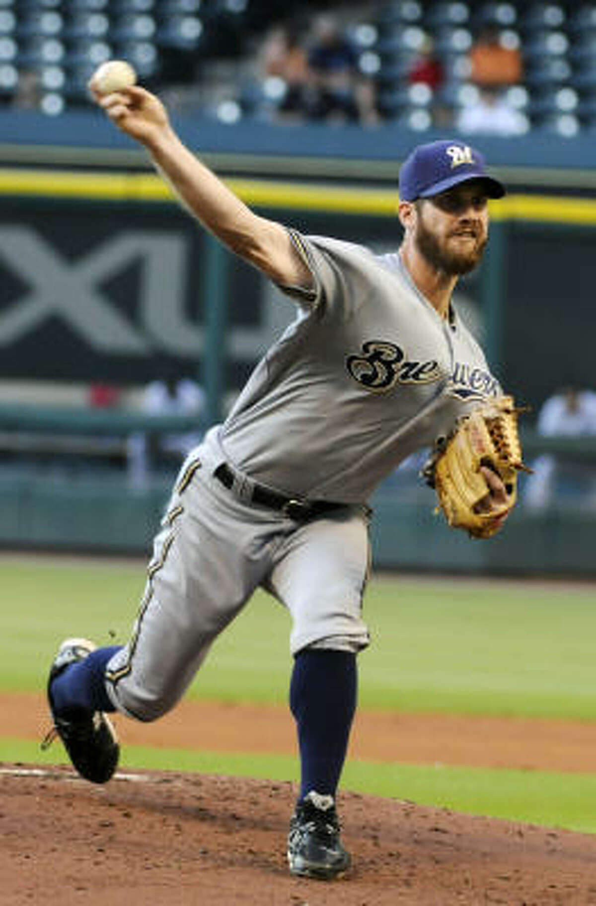 Milwaukee Brewers' Dave Bush delivers a pitch in the first inning.