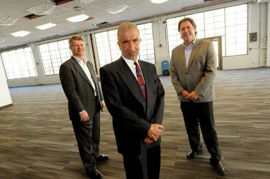 Rick Whitney, CEO of M + W Group, left, Alain Kaloyeros, Senior Vice President and CEO  of Nanoscale Science and Engineering, center, and Peter Gannon, President of Arsenal Business and Technology, in the open office space of M + W new headquarters on Thursday, Aug. 4, 2011, at the Watervliet Arsenal in Watervliet, N.Y. (Cindy Schultz / Times Union) Photo: Cindy Schultz