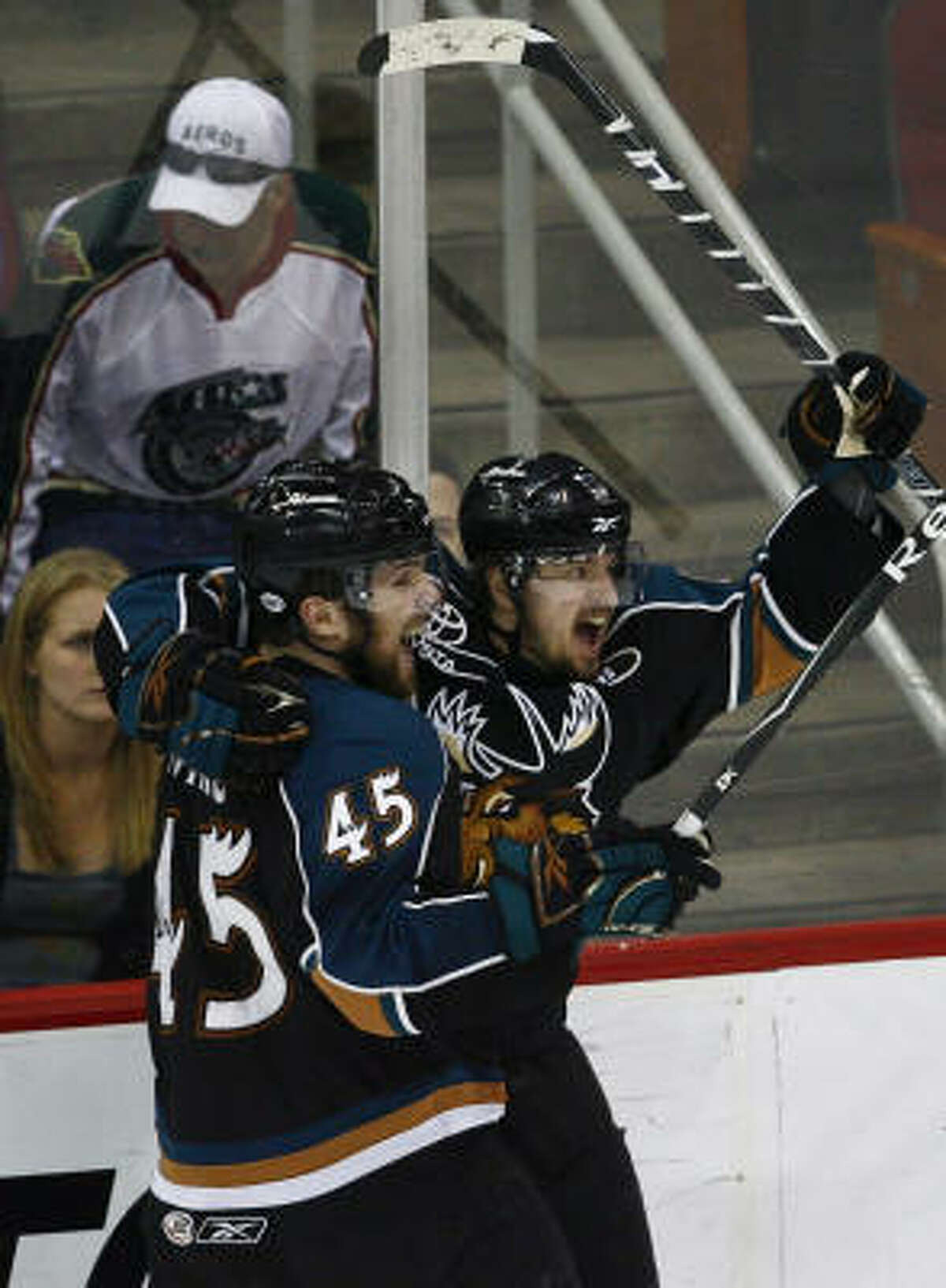 Manitoba's Michael Grabner (right) celebrates with Mark Fistric after scoring the winning goal in the third period.