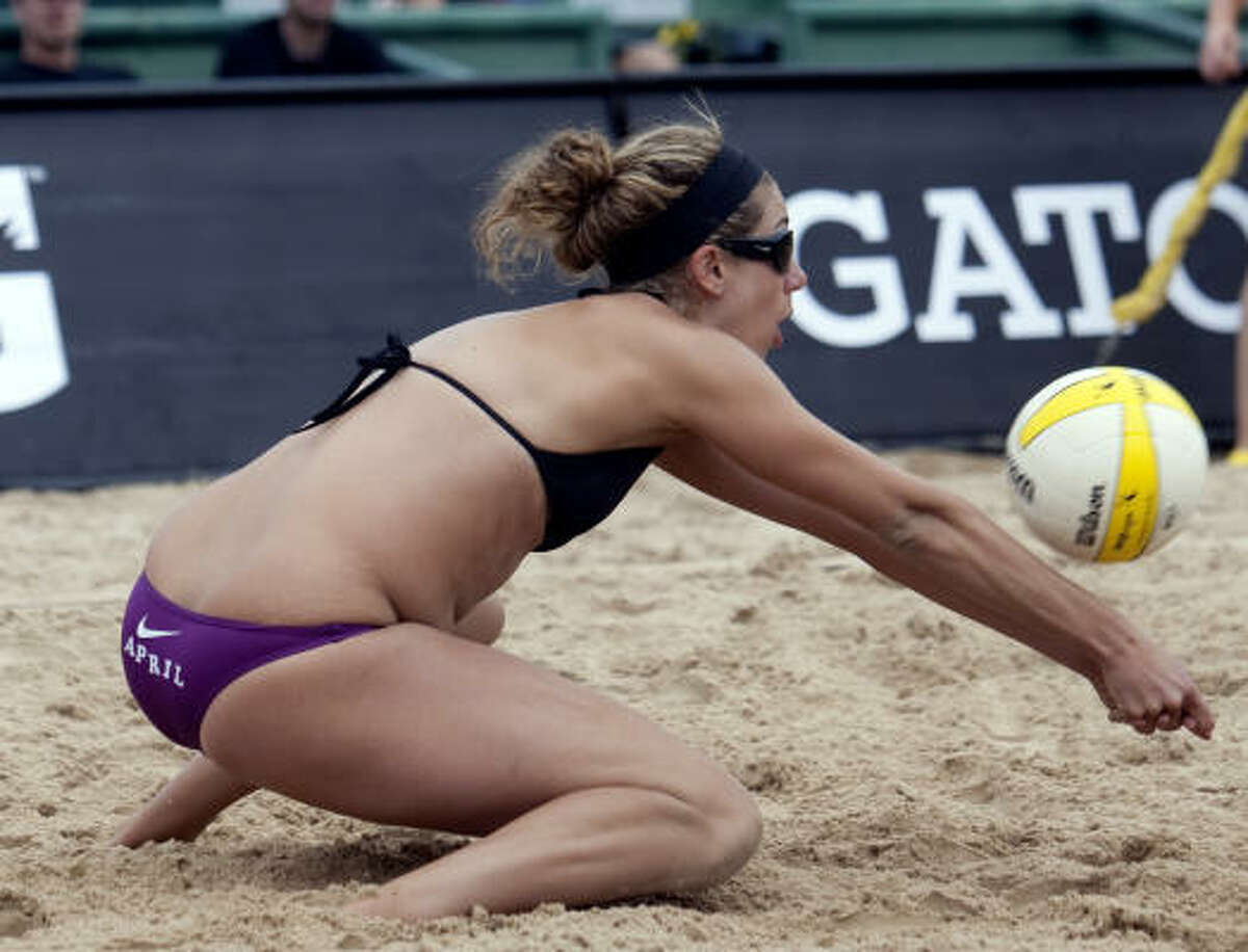 April Ross digs the ball during the womens' championship match.