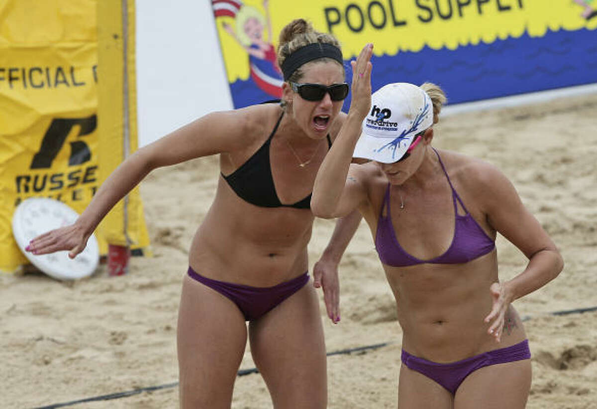April Ross, left, and Jennifer Kessy celebrate after winning a point.