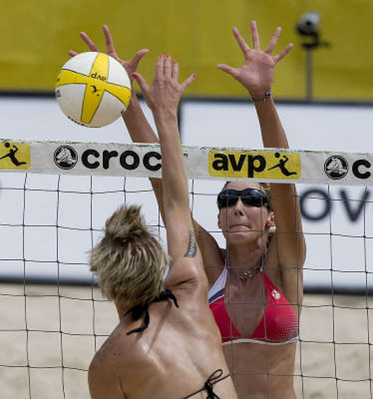 Brittany Hochevar is blocked at the net by Jenny Kropp during their match at the AVP CROCS Tour Houston Open.