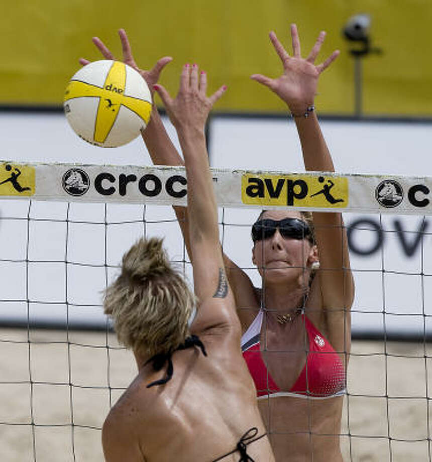Brittany Hochevar is blocked at the net by Jenny Kropp during their match at the AVP CROCS Tour Houston Open. Photo: Bob Levey, For The Chronicle