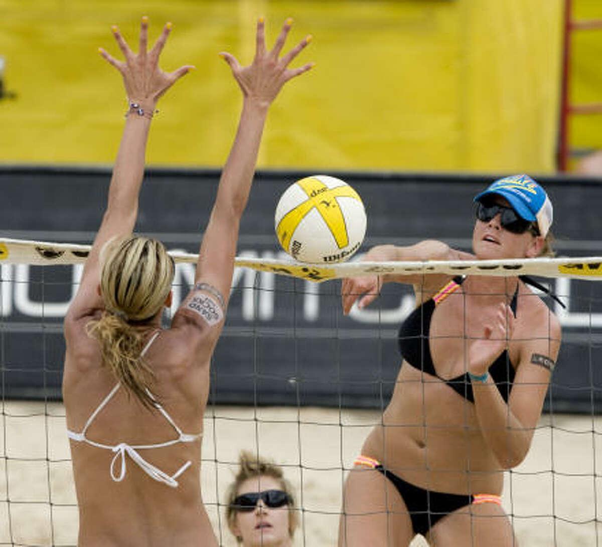 Jennifer Fopma hits at the net over Jenny Kropp.