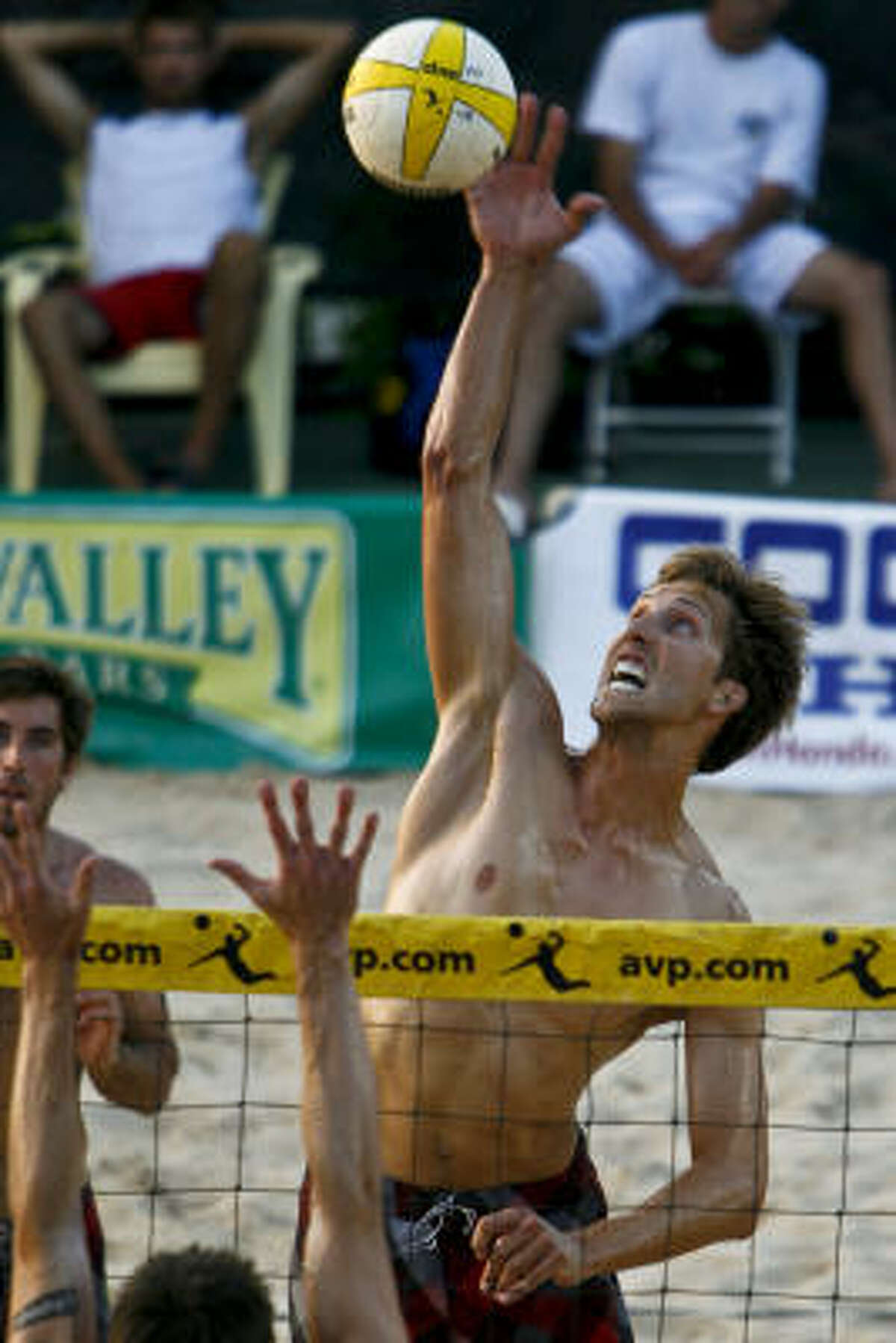 Will Strickland goes up for a spike as he and his partner Aaron Wachtfogel battle against Russ Marchewka and Evan Engle.