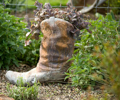 Cowboy boot-shaped planter from the Guyton family garden in Montgomery. Photo: Mark Robinson, For The Chronicle