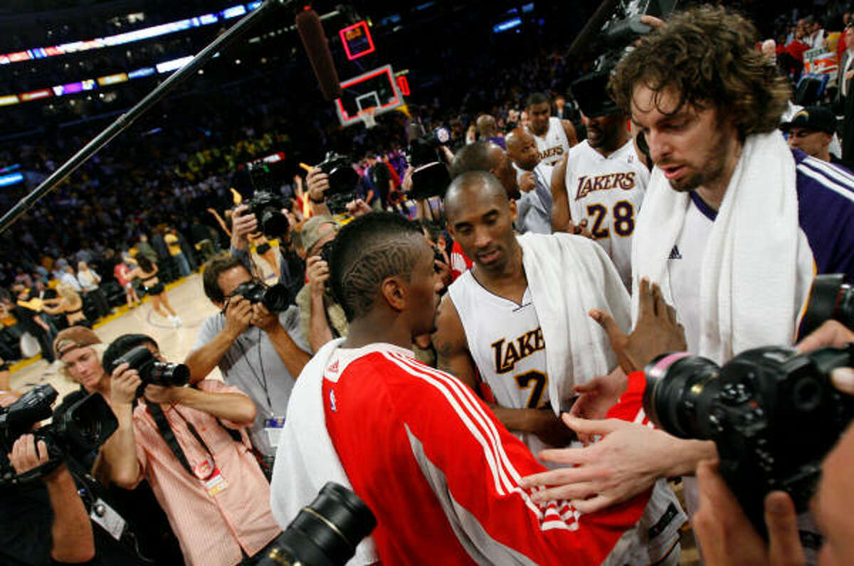 Ron Artest, left, congratulates Kobe Bryant, center and Pau Gasol after the game.