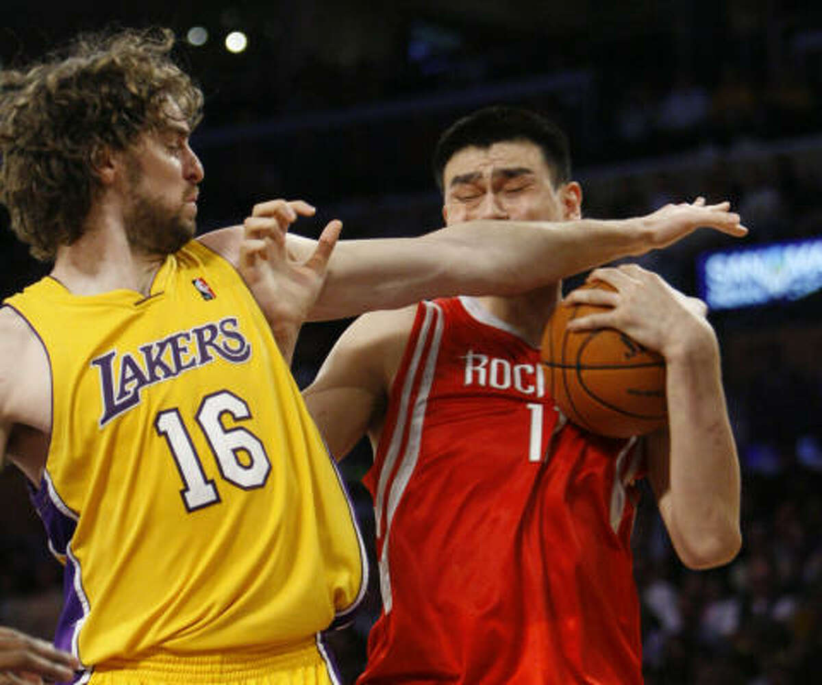 May 6, Game 2: Lakers beat Rockets 111-98 - Lakers center Pau Gasol gives Yao Ming a forearm in the first half. Statistics | Series tied 1-1