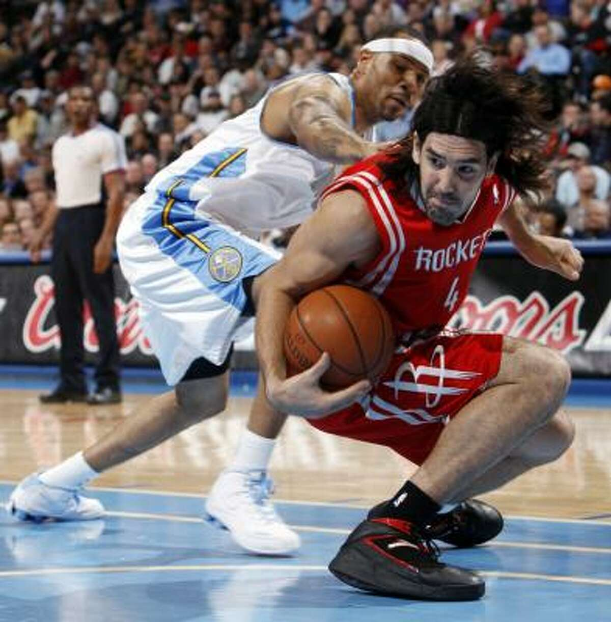 Rockets defeat Nuggets 97-95 . Luis Scola, front, picks up a loose ball ahead of Nuggets forward Kenyon Martin in the first quarter. The Rockets missed 15 free throws but managed to hold off Denver's fourth-quarter rally. Statistics | Record: 42-23