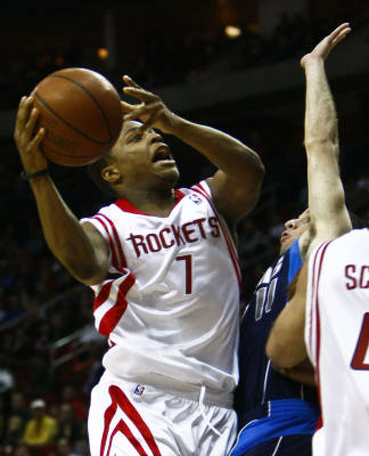 Newly acquired Rockets guard Kyle Lowry drives to the basket in the fourth quarter.
