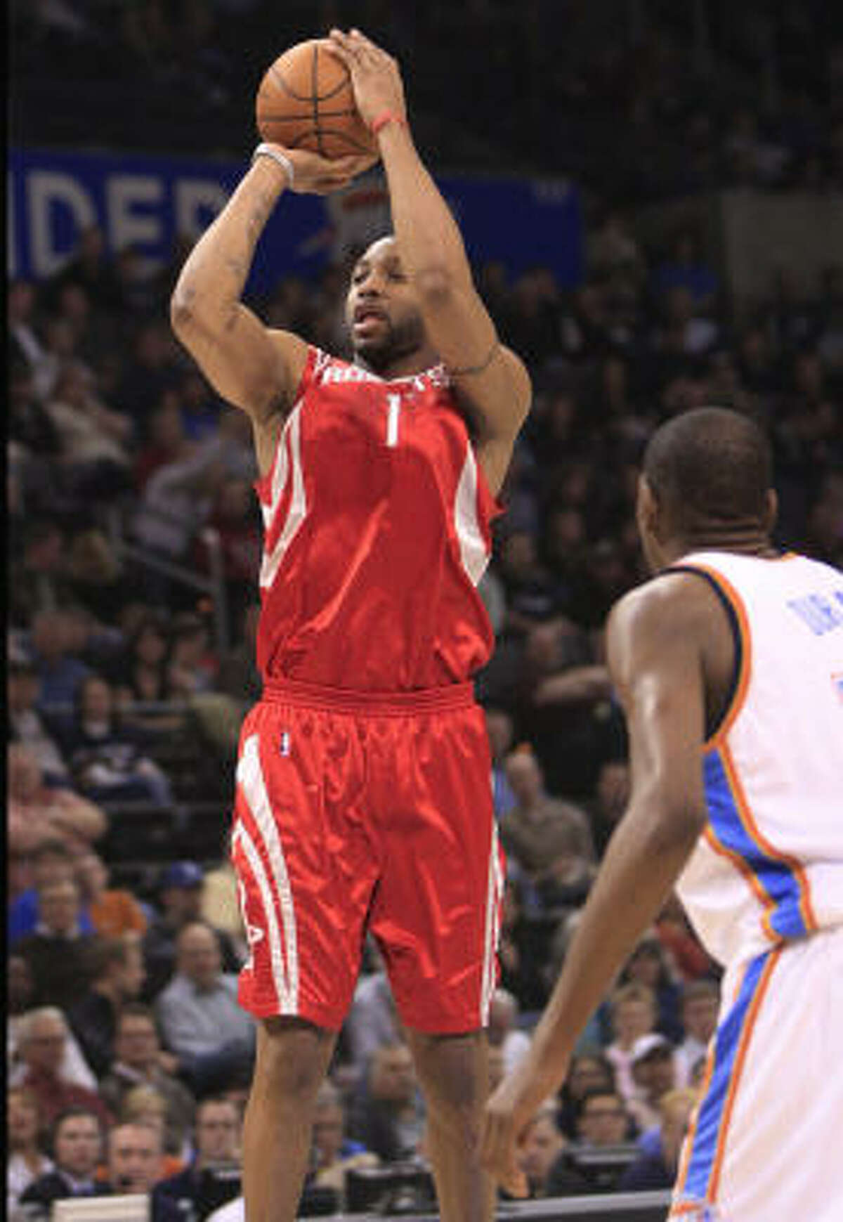 Tracy McGrady, center, was back in the lineup Friday after sitting out Wednesday's win in Boston to rest his sore knee. Here, he shoots over Thunder guard Kevin Durant in the first quarter.