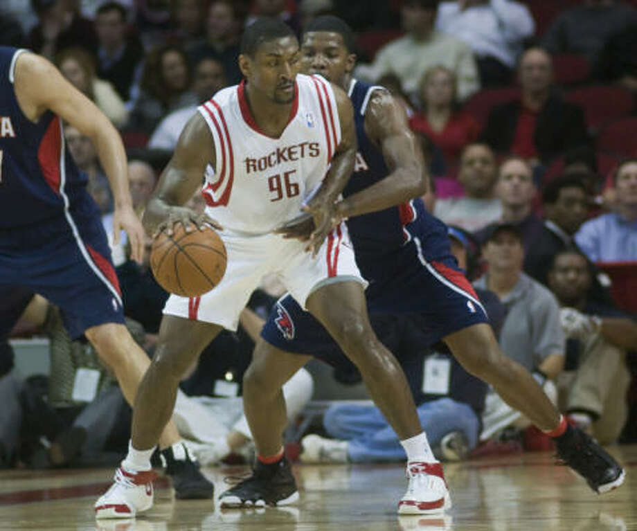 Ron Artest was back in action Tuesday night against Joe Johnson and the Hawks. Photo: Steve Ueckert, Chronicle