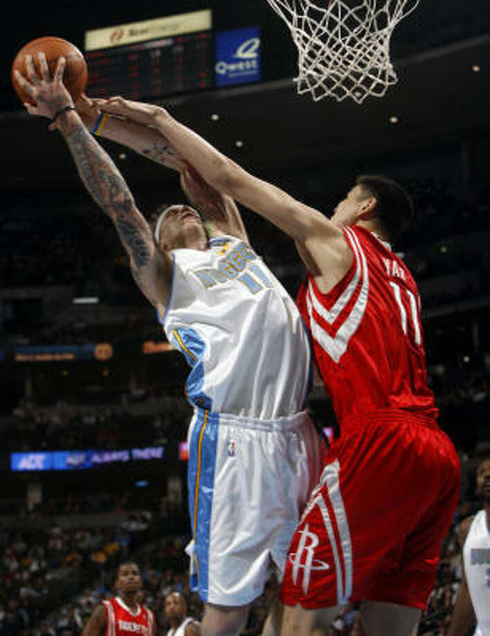 Denver Nuggets forward Chris Andersen has his shot blocked by Houston Rockets center Yao Ming in the fourth quarter. Photo: David Zalubowski, AP