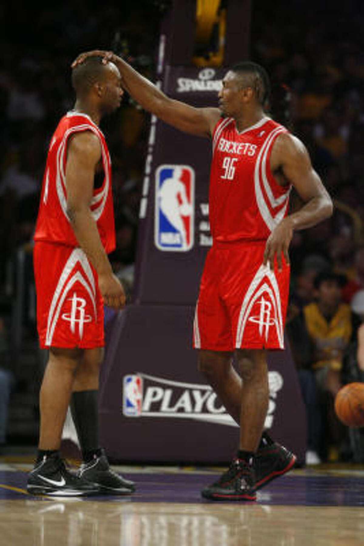 Rockets forward Ron Artest, left, consoles teammate Carl Landry in the second quarter.