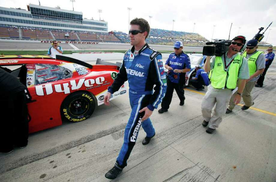 Carl Edwards walks to his car before qualifying for the NASCAR Nationwide Series auto race Saturday, Aug. 6, 2011, at Iowa Speedway in Newton, Iowa. (AP Photo/Charlie Neibergall) Photo: Charlie Neibergall, STF / AP
