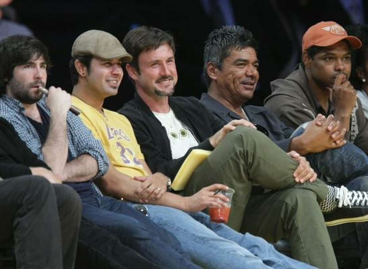 Game 7: Actor David Arquette, center, and comedian George Lopez, second from right.