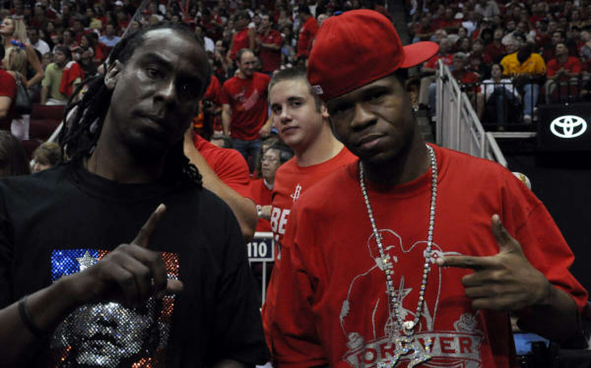 Date: May 14 Series: Rockets vs. Lakers (2nd round) Game: 6 Rapper Chamillionaire and his brother Rasaq check out the Rockets game.