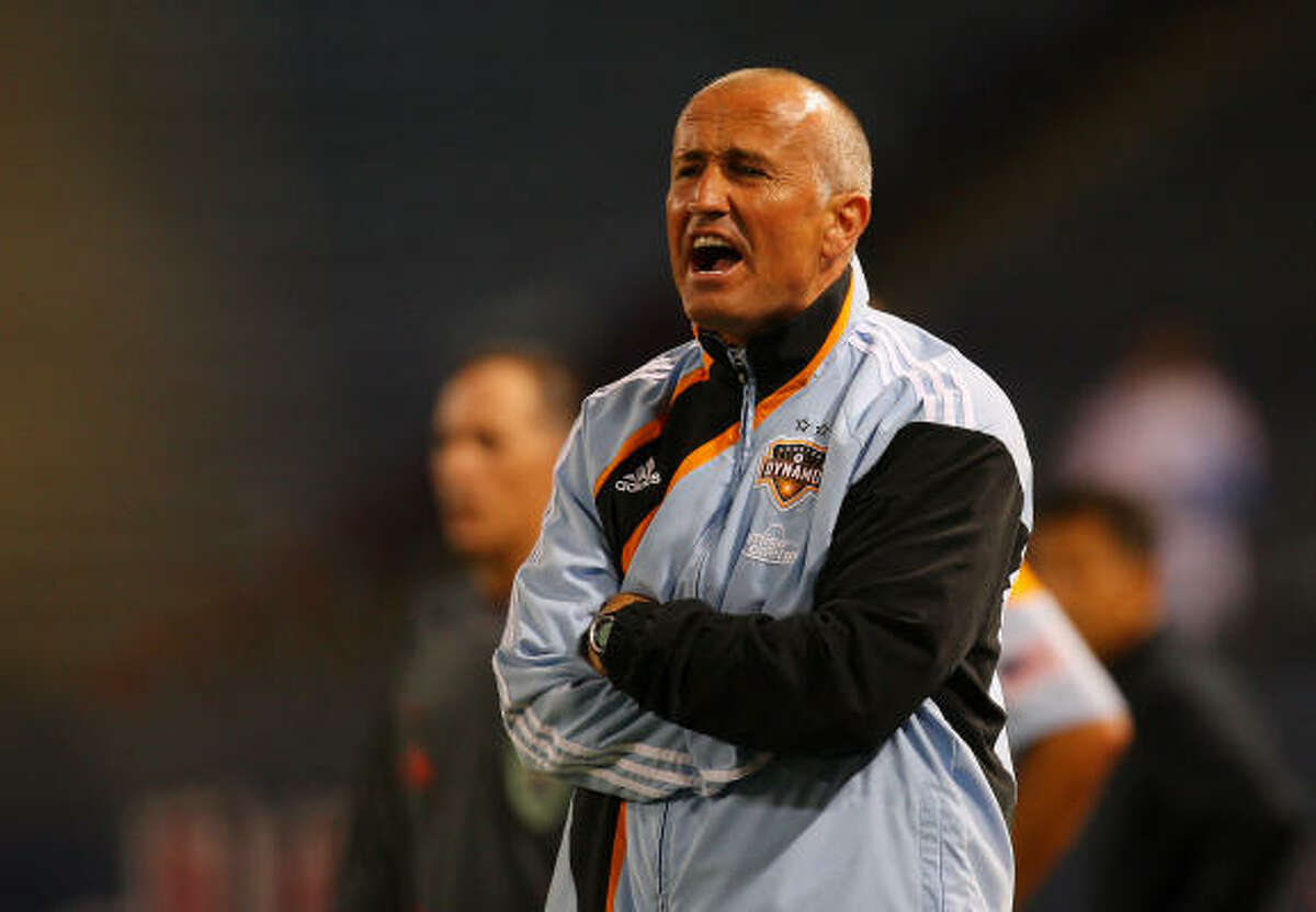 Dynamo head coach Dominic Kinnear reacts from the bench.