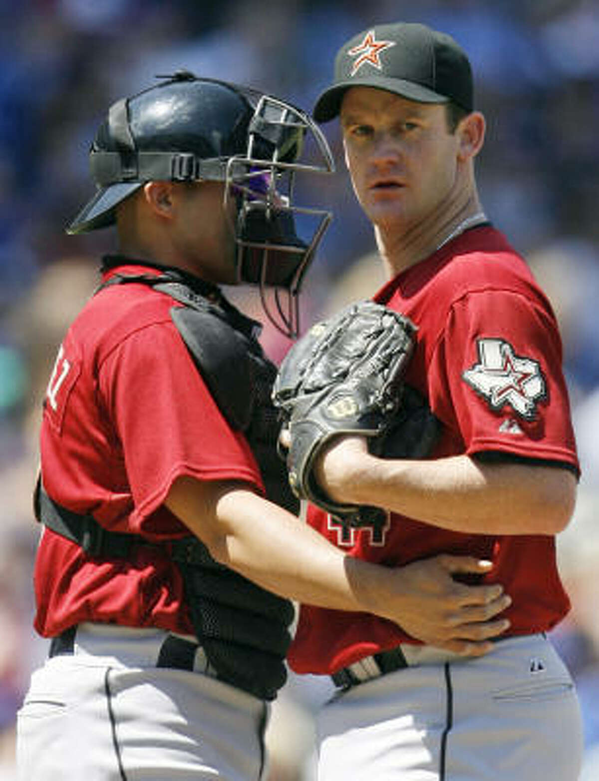 Roy Oswalt, right, gave up just two hits through five innings, but then ran into trouble.