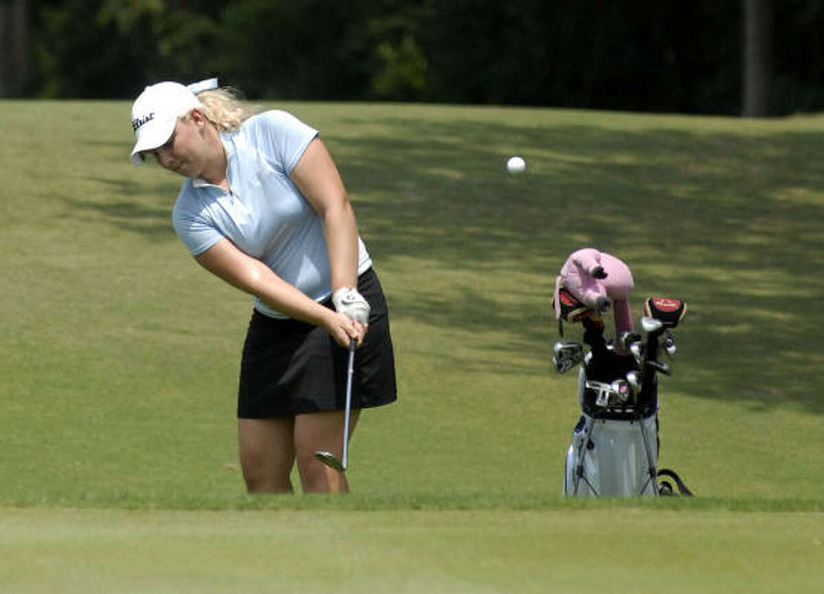 Portland Rosen of Clements chips on No. 3 Friday. She shot a 66 en route to winning the girls title.