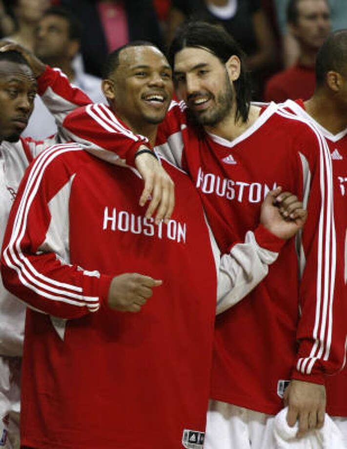 Rockets center Chuck Hayes, left, and Luis Scola embrace during the fourth quarter with the game well in hand. The Rockets forced a Game 7 by beating the Lakers at Toyota Center on Thursday. Photo: Brett Coomer, Chronicle
