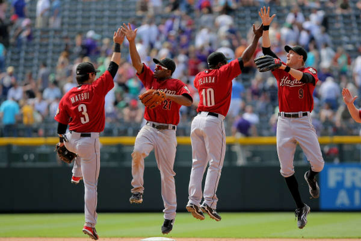 Kazuo Matsui (3), Michael Bourn (21), Miguel Tejada (10) and Hunter Pence (9) celebrate after defeating the Colorado Rockies 5-3 in the series finale.