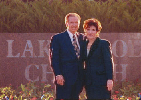 Pastors John and Dodie Osteen pose for a picture outside of the new sanctuary.