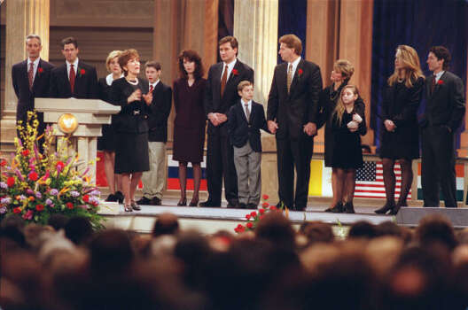 Pastor John Osteen died of cardiac arrest in January of 1999.  Here, Dodie Osteen speaks at his memorial service on January 27, 1999, with family members standing behind her in the Lakewood Church sanctuary. Photo: E. Joseph Deering, Houston Chronicle