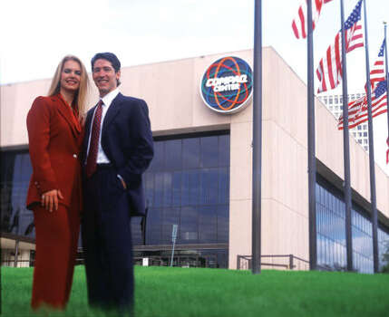 In 2005, Lakewood moved into the Compaq Center, the former Summit and former home of the Houston Rockets. Before they move in, Pastor Joel and Victoria Osteen pose outside the building. Photo: Provided By Lakewood Church