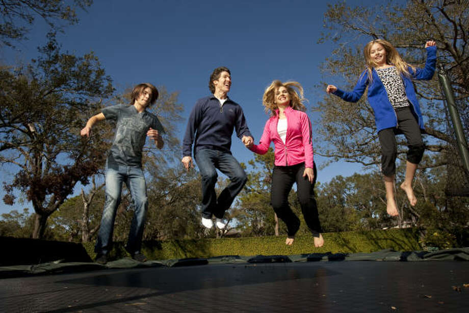 Having grown up in an active family, Lakewood Church's Victoria Osteen incorporates her husband Joel, and two kids Jonathan, far left, and Alexandra, far right, into her regimen of healthy foods, exercise and maintaining a positive attitude. Photo: Robert Seale, © 2009 Robert Seale