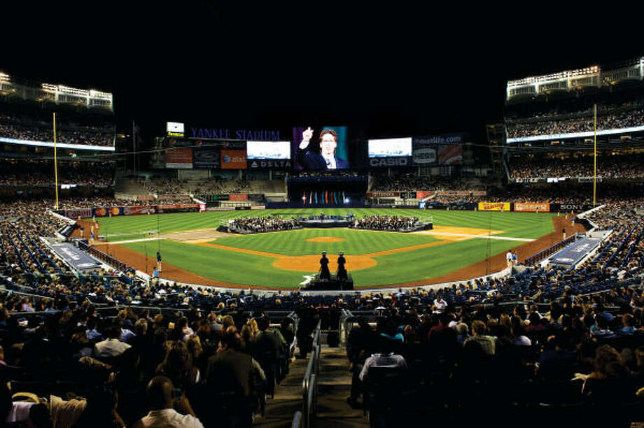 The Osteen family has taken its message on tour. Here Pastor Joel Osteen speaks during 'A Night of Hope' worship service at Yankee Stadium on April 25, 2009. Photo: Ron Wyatt, Provided By Lakewood Church